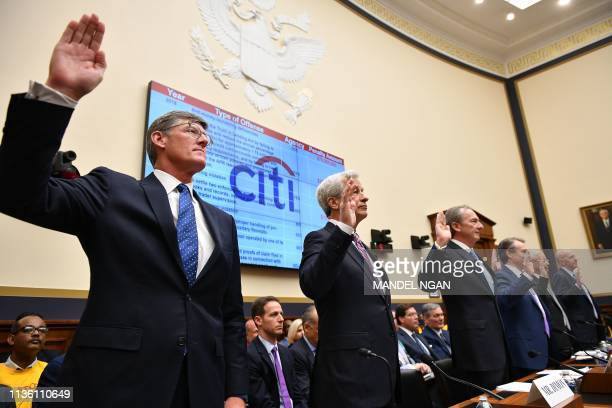 Citigroup Chief Executive Officer Michael CorbatJP Morgan Chase Co Chairman Chief Executive Officer James Dimon and others are sworn in before they...