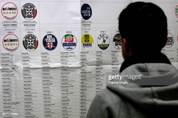 A citizen arrives at the polling station to vote in the Italian General Election on March 4 2018 in Rome Italy The economy and immigration are key...