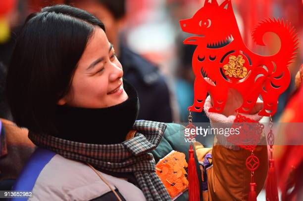 A citizen buys decorations for the upcoming Lunar New Year on February 3 2018 in Hefei Anhui Province of China Chinese People are preparing for the...