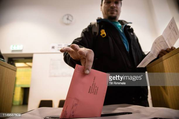 A citizen casting his absentee ballot on May 16 2019 in Berlin Germany Early voting is underway ahead of European parliamentary elections that will...