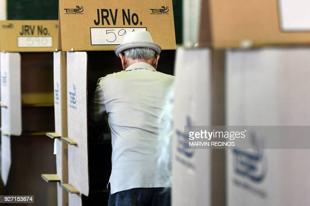 A citizen casts his vote during legislative and municipal elections in San Salvador on March 4 2018 Legislative elections in El Salvador will test...