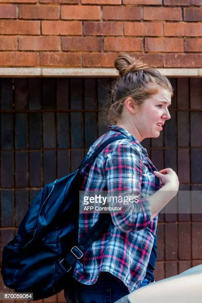 US citizen Martha O'Donovan who was arrested for undermining the authority of Zimbabwe President Robert Mugabe on Twitter arrives at Harare...