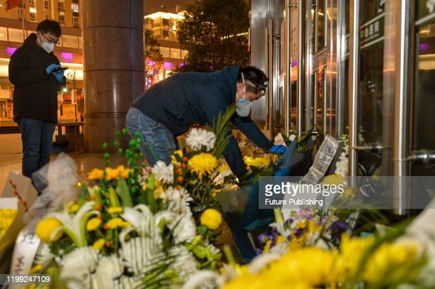 A citizen pays tribute to Dr Li Wenliang at Li's hospital in Wuhan in central China's Hubei province Friday Feb 07 2020 Li regarded a whistleblower...
