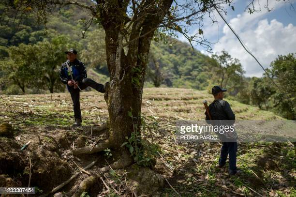 Citizen policemen stand in guard at Nahuat community of Ayahualtempa, Guerrero state, Mexico, on June 6, 2021. - Mexicans began voting Sunday in...