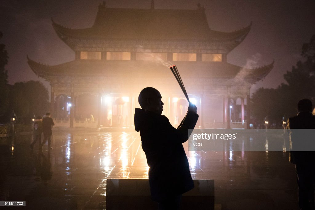 A citizen prays with incense sticks to celebrate the Lunar New Year, marking the Year of the Dog, at a temple on February 15, 2018 in Hefei, Anhui Province of China. The Lunar New Year falls on February 16 this year.