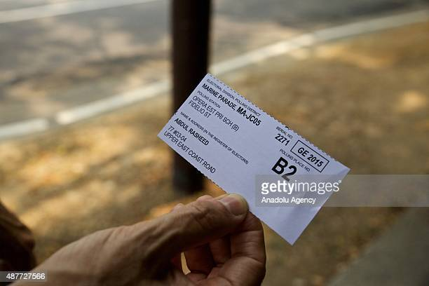 A citizen shows his voter paper outside the St Stephens School one of the polling stations during the Singapore General Elections on September 11 2015
