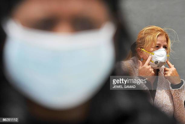 US citizen Soraya Bravo fixes her face mask after arriving from Mexico near the international border between US and Mexico in San Ysidro California...