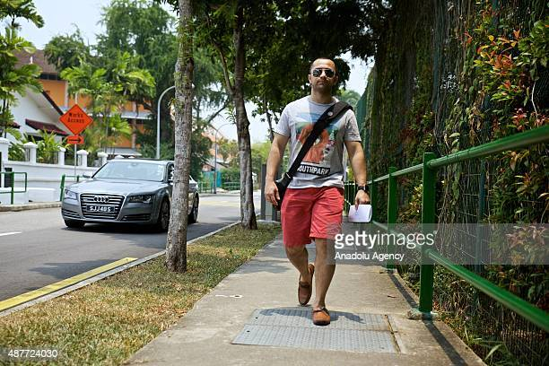 A citizen walk towards to the St Stephens School one of the polling stations during the Singapore General Elections on September 11 2015