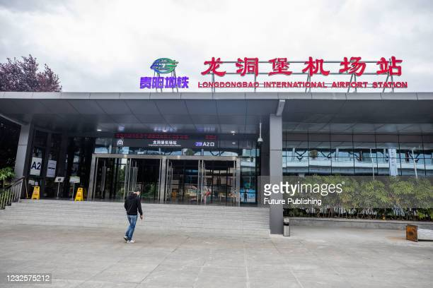 Citizen walks into the Longdongbao Airport Station of Subway Line 2 in Guiyang, southwest China's Guizhou Province, April 28, 2021. Guiyang Metro...