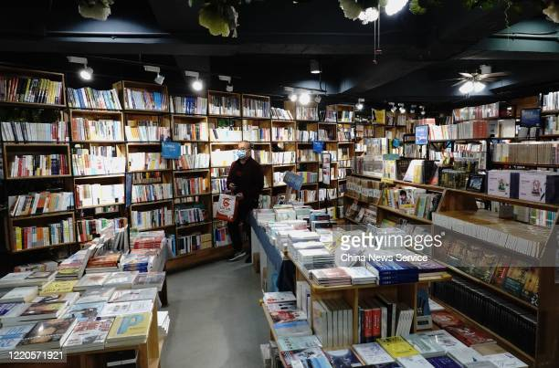 A citizen wearing face mask buys books at a bookstore on World Book Day on April 23 2020 in Zhengzhou Henan Province of China Zhengzhou issues 10...