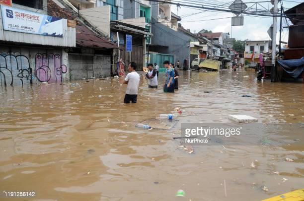 Citizens' activities during flood conditions in the residential and commercial areas of Kampung Pulo, Jatinegara, Jakarta, January 2020. Floods that...