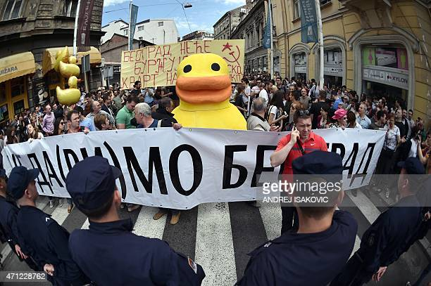 Citizens and activists from the civic group 'Let Us Not Drown Belgrade' march with a 2meter tall yellow styrofoam duck the symbol of a protest...