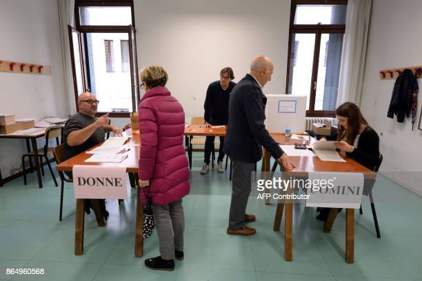 Citizens are about to vote at a polling station during an autonomy referendum in Venice, on October 22, 2017. The consultative votes are only the...