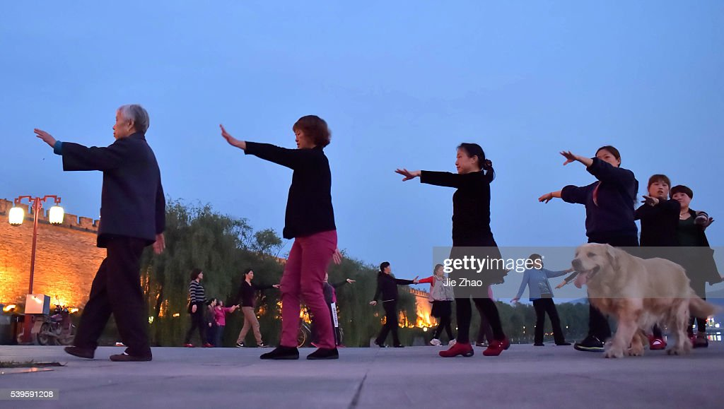 Citizens are dancing at a public square in Xiangyang, Hubei province, central China 22th April 2015.