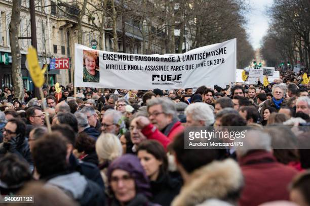 Citizens at the Silent March In Memory Of Mireille Knoll who survived the Holocaust but was recently murdered in her home on March 28 2018 in Paris...