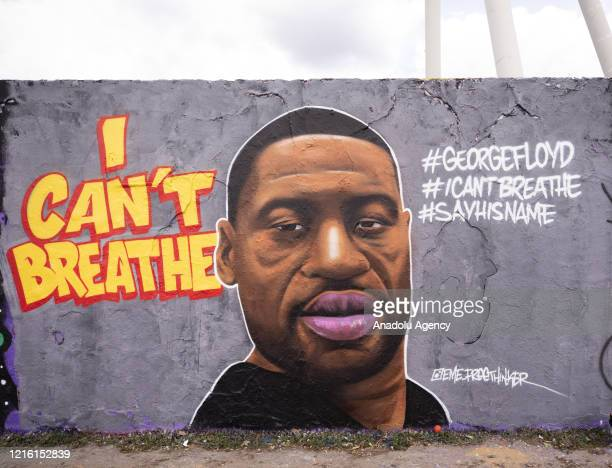 Citizens came to Mauer Park to inspect and to take photos in front of the mural of George Floyd who died in police custody in Minneapolis of USA on...