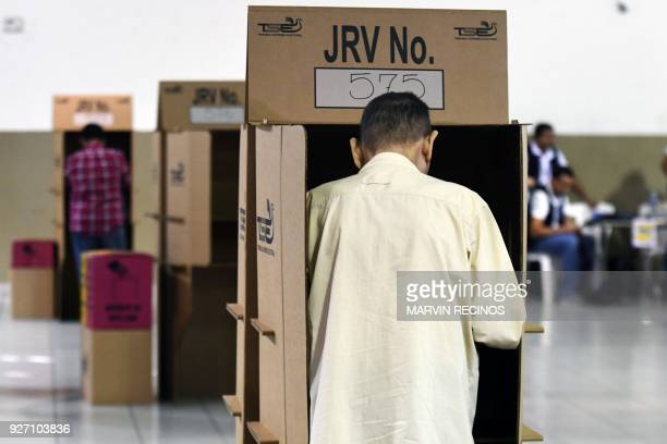 Citizens cast their vote during legislative and municipal elections in San Salvador on March 4 2018 Legislative elections in El Salvador will test...