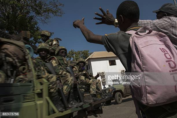 Citizens celebrate the arrival of ECOWAS troops around the Government House after the former President Yahya Jammeh fled the country, in Banjul,...