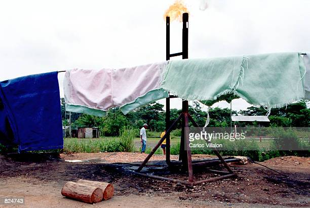 Citizens dry their wash using the heat from an oil burning smokestack March 25 2001 in La Victoria Ecuador Environmentalists from The Front For The...