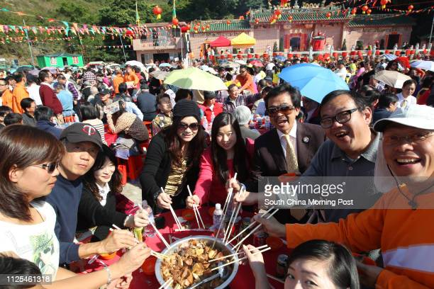 Citizens enjoy a big bowl feast at the completion ceremony for the restoration of the Tin Hau Temple on High Island, Sai Kung. 02JAN13