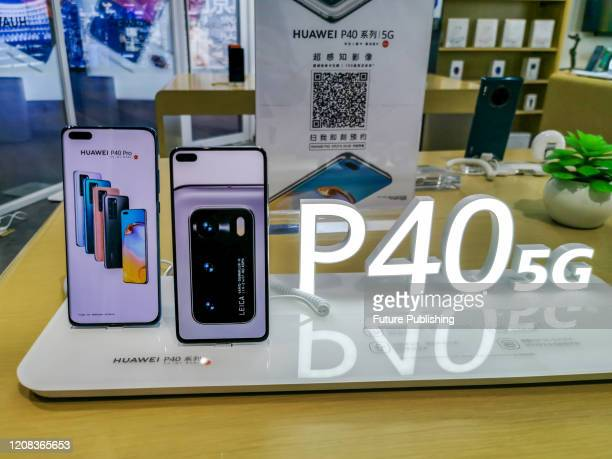 SHANGHAI CHINA MARCH 272020 Citizens experience Huawei's newly released P40 series mobile phones in its exclusive stores Shanghai China March 27 2020...