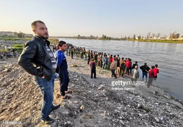 Citizens follow the search and rescue operations around the site after a ferryboat sank in Iraqs Tigris River on Thursday leaving at least 55 people...