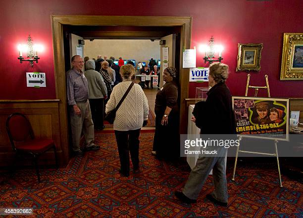 Citizens go to the cast their ballots at the Charles Allis Art Museum on election day November 4 2014 in Milwaukee Wisconsin Republican Gov Scott...
