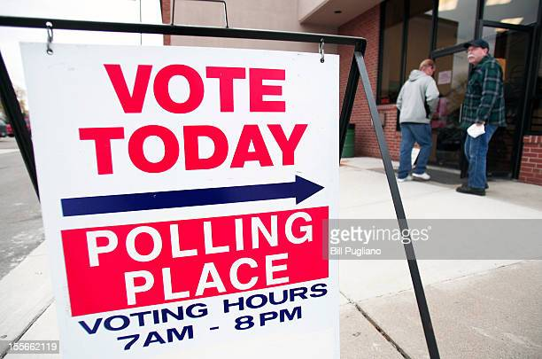 S citizens go to the polls to vote in the presidential election at the Owen Jax Recreation Center November 6 2012 in Warren Michigan The race between...
