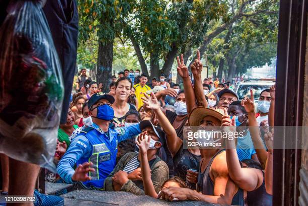 Citizens in need react after a local charity runs out of bags of essential food. Over 60% of people in Honduras live in poverty. During the...