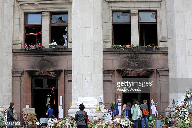 Citizens in Odessa visit the syndicate building to commemorate the ones who lost their lives on Friday, May 2 clashes, and place flowers all around...