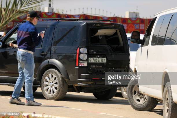 Citizens inspect a car bomb belonging to the convoy of the Palestinian Prime Minister Rami alHamdallah after being targeted by an explosion during...