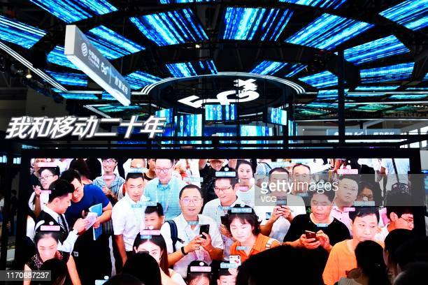 Citizens interact with face recognition system on day two of 2019 Smart China Expo at Chongqing International Expo Center on August 27 2019 in...