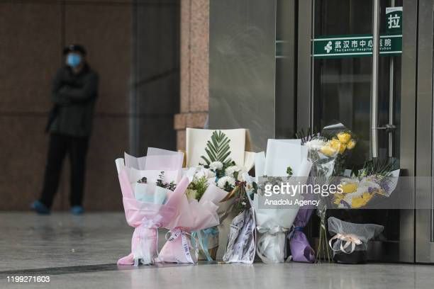 Citizens lay flowers as they mourn doctor Li Wenliang on February 72020 in Wuhan China Dr Li Wenliang regarded a whistleblower on the pneumonia...