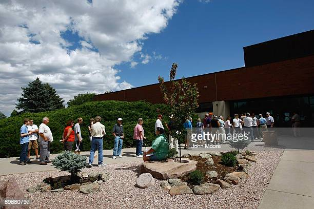 Citizens line up to attend a health care town hall meeting with Rep Betsy Markey on August 19 2009 in Greeley Colorado Markey had planned to only...