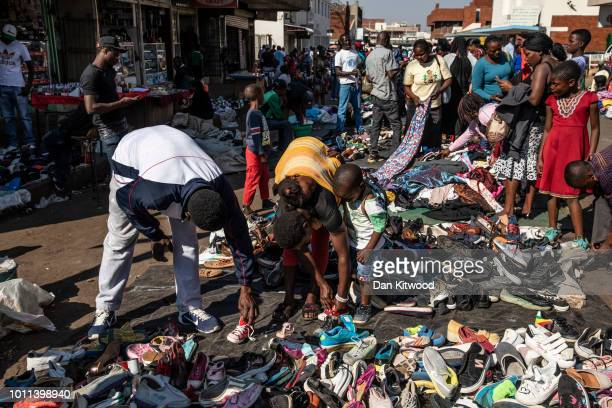Citizens look through a clothes market on August 05 2018 in Harare Zimbabwe The import of second hand clothes into the informal sector in Zimbabwe...