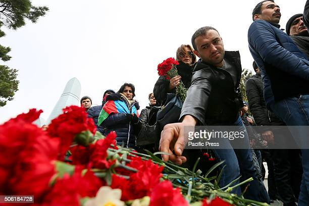 Citizens of Baku leaves flowers on the Alley of Martyrs a cemetery and memorial dedicated to those killed by Soviet troops during the 1990 Black...