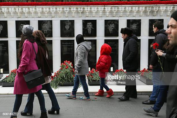 Citizens of Baku walking during their visit to the Alley of Martyrs Citizens of Baku visits the Alley of Martyrs a cemetery and memorial dedicated to...