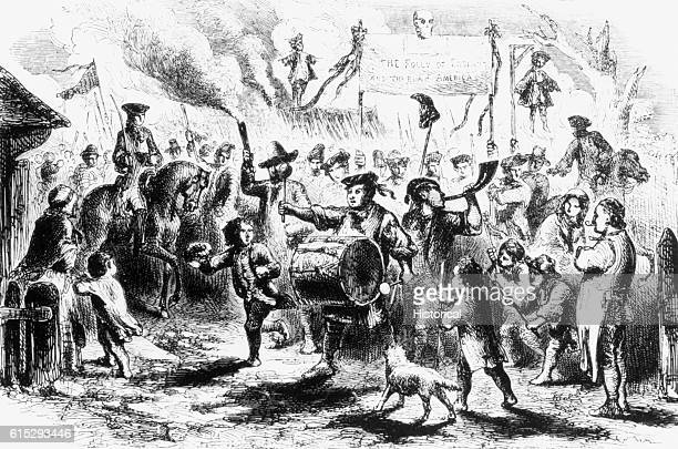 Citizens of Boston protest the enactment of the Stamp Act by British Parliament in 1765