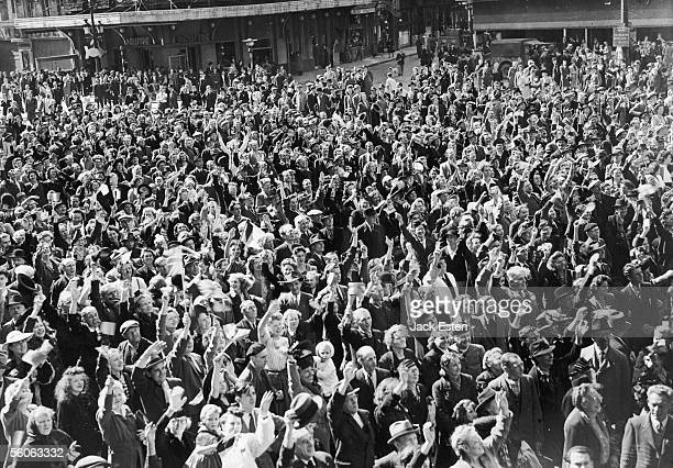 Citizens of Brussels cheer the arrival of the British liberating forces during World War II, September 1944.