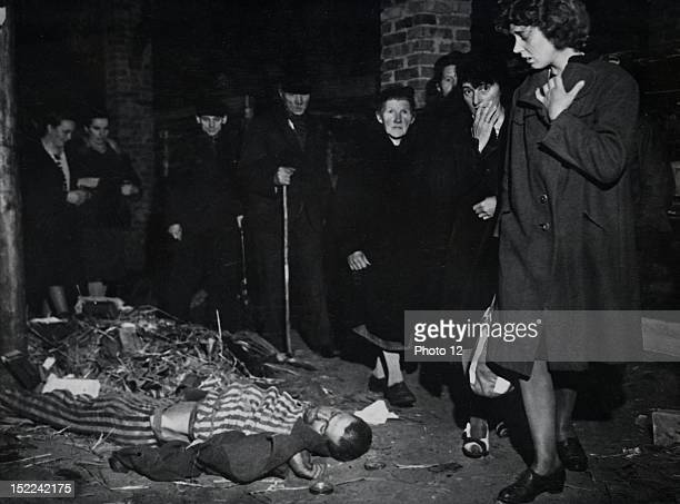 Citizens of Ludwigslust inspect the Wobbelin camp under order of the 82nd US Airborne Division A dead victim still dresses in the Nazi convict garb...