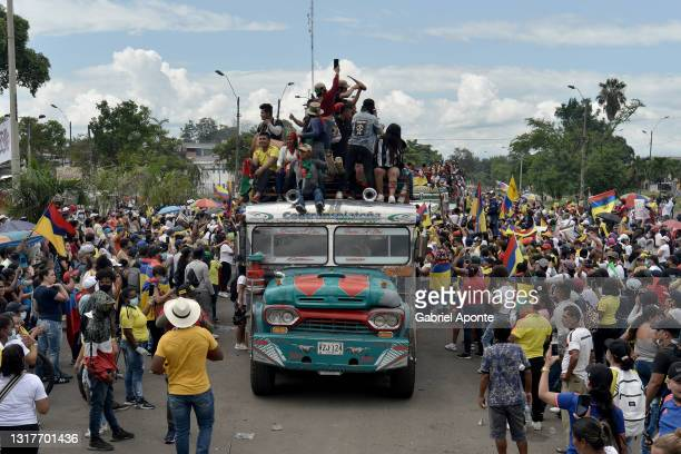 Citizens of the Puerto Resistencia sector greet and thank the Indigenous Minga as they pass through before returning to their territories during...