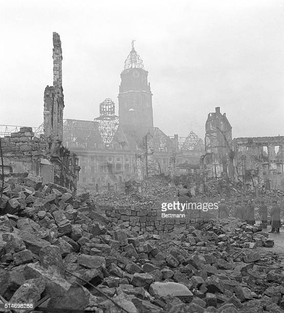 Citizens of the rubblestrewn city of Dresden prepare to dig out after Allied bombing runs reduced the city to ruins