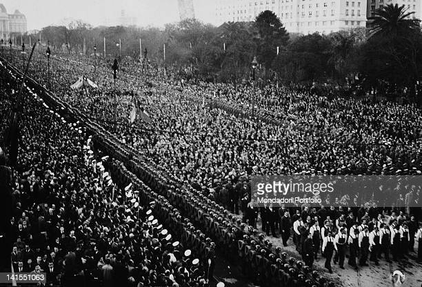 Citizens packing the capital city's boulevard during the funeral of Evita Peron the wife of the Argentinian President Buenos Aires July 1952