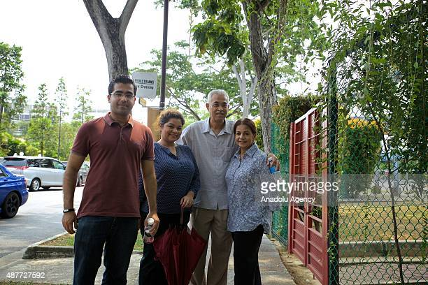Citizens poses outside the Opera Estate Primary School , one of the polling stations, during the Singapore General Elections on September 11, 2015.