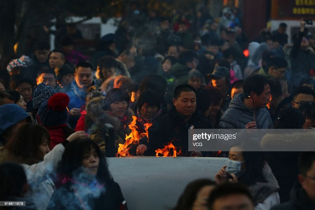 Citizens pray with incense sticks to celebrate the Lunar New Year, marking the Year of the Dog, at the Lama Temple on February 16, 2018 in Beijing, China. The Lunar New Year falls on February 16 this year.