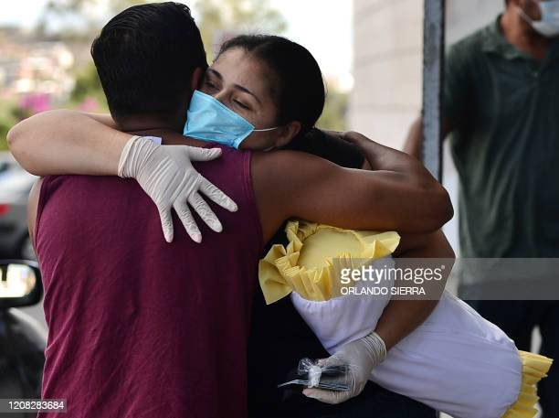 US citizens prepare to board a commercial flight to return to their country during the outbreak of the new coronavirus COVID19 at Toncontin...