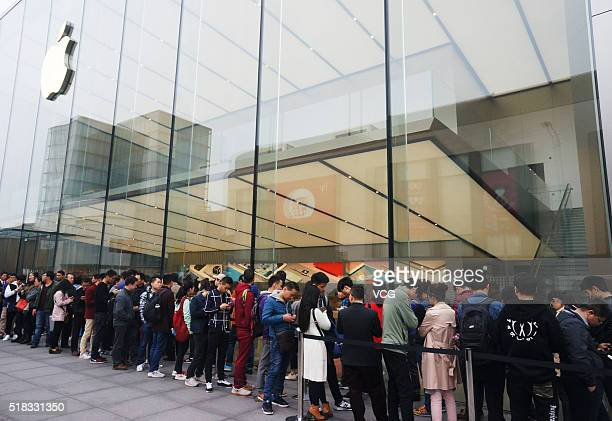 Citizens queue up outside an Apple Store as Apple launches its iPhone SE globally on Thursday on March 31 2016 in Hangzhou Zhejiang Province of China...