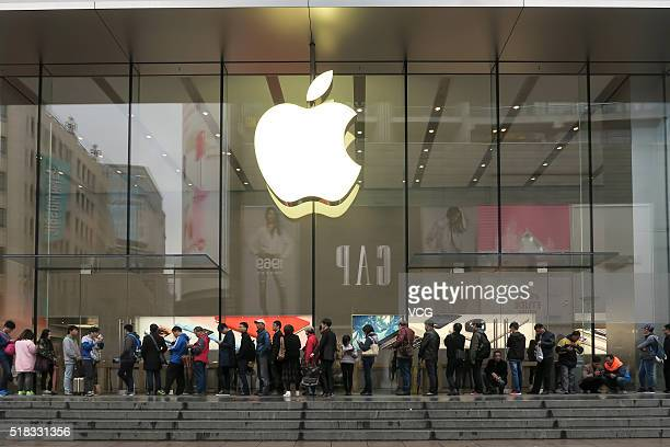 Citizens queue up outside an Apple Store as Apple launches its iPhone SE globally on Thursday on March 31 2016 in Shanghai China Apple's new 4inch...