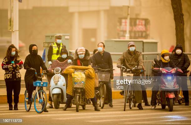 Citizens ride motorbikes in sandstorm on March 15, 2021 in Hohhot, Inner Mongolia Autonomous Region of China. Sandstorm blankets parts of regions in...