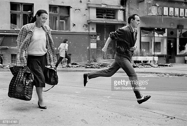 Citizens sprint across 'Sniper Alley' during the siege of Sarajevo in 1994.